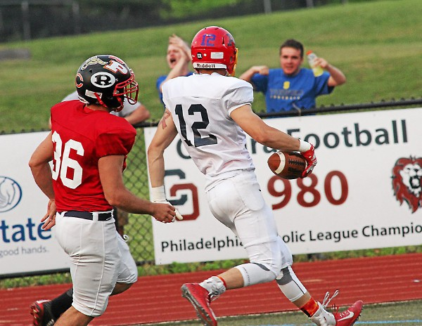 East receiver Nick Costello of Haverford catches a touchdown pass as Chris Alyankian of Penncrest pursues for the West. (Robert J Gurecki)